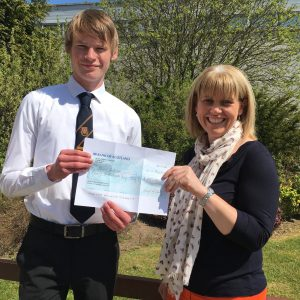 Stuart's receives his prize cheque from Mackie Academy head, Louise Moir. Photo by Lynda Swanson.